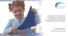 Child folding Montessori classroom
