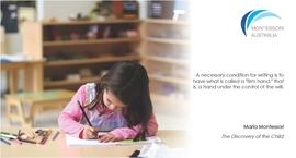 Child writing in a Montessori classroom